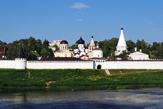 The Uspensky monastery and Trinity Church on the bank of the river of Volga in the city of Staritsa. Tver region. Russia. The Uspensky monastery and Trinity Stock Image