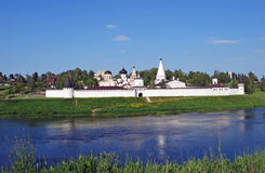 The Uspensky monastery and Trinity Church on the bank of the river of Volga in the city of Staritsa. Tver region. Russia. The Uspensky monastery and Trinity Stock Photography