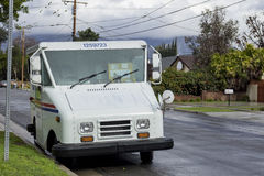 USPS delivery in a rainny day Royalty Free Stock Images