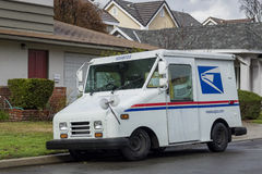 USPS delivery in a rainny day Stock Photo