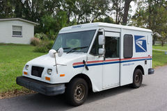 USPS Delivery Van. JACKSONVILLE, FL - OCTOBER 28, 2016: A United States Postal Service, USPS, collection and delivery van in a residential neighborhood. The USPS royalty free stock photo