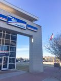 USPS logo close-up at store facade entrance in Irving, Texas, US stock photography