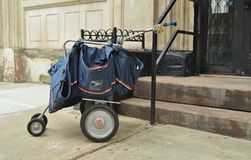 Post Office Mail Cart. USPS Post Office Blue Mail Cart in Front of a New York City Residential Building Royalty Free Stock Photos
