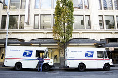 USPS postal service trucks. Two USPS trucks were parked in front of the office buildings at downtown Seattle Royalty Free Stock Photography