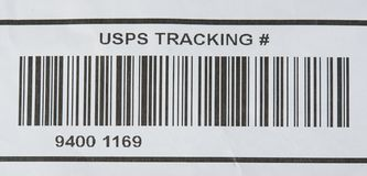 USPS tracking number and bar code. New york, USA - october 1, 2018: USPS tracking number and bar code printed on paper royalty free stock images