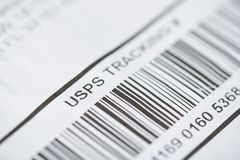 USPS tracking number. New york, USA - october 1, 2018: USPS tracking number close up view with bar code royalty free stock photography