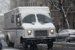 USPS truck in snow storm in the Bronx. BRONX, NEW YORK - JANUARY 7:: United States Postal Service truck in snow storm.  Taken January 7, 2017 in New York Royalty Free Stock Photos