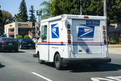 USPS vehicle driving on a busy street. July 5, 2018 Sunnyvale / CA / USA - USPS vehicle driving on a busy street in south San Francisco bay area royalty free stock photography