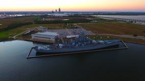 USS Alabama en la puesta del sol foto de archivo libre de regalías