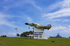 Uss Alabama memorial park entrance exhibit. MOBILE - MAY 12: USS Alabama warship museum enterance exhibit, aircraft fighter on May 12 2017 in MOBILE, USA Stock Image