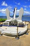 Pearl Harbor USS Arizona Memorial Anchor. USS Arizona Memorial is seen in far background thru anchor of the USS Arizona recovered from ocean floor Royalty Free Stock Image