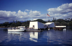 USS Arizona Memorial and Foot Ferry. Tourists begin to load the military foot ferry that transports from the main naval base at Pearl Harbor to Ford Island in Stock Image