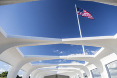USS Arizona Structure and Flag. Pearl Harbor, Hawaii - January 11, 2015: The American flag seen from inside the USS Arizona Memorial in Pearl Harbor, Hawaii royalty free stock photos