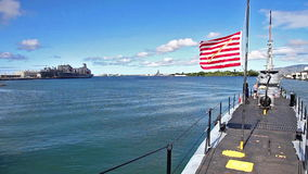 USS Bowfin Submarine. HONOLULU, OAHU, HAWAII, USA - AUGUST 21, 2016: USS Bowfin Submarine SS-287 with American First Navy Jack flags at Pearl Harbor Honolulu stock video footage