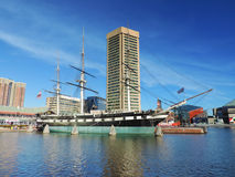 USS Constellation with the Baltimore World Trade Center royalty free stock photos