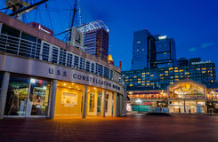 USS Constellation Museum and Pratt Street Pavilion during twilight, at the Inner Harbor in Baltimore, Maryland. Royalty Free Stock Image