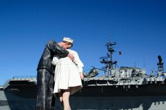 USS Midway. San Diego,CA:Dec. 27th, 2011. A statue of a sailor kissing a woman across from the USS Midway, which is now a museum in San Diego,CA Royalty Free Stock Photography