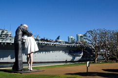 USS Midway. San Diego, Ca, USA - December 27, 2011: A statue and the USS Midway in the background. The USS Midway is now a museum Stock Images