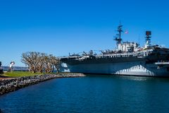 The USS Midway, retired Navy ship, stands at San Diego harbor on Pacific Ocean royalty free stock photos