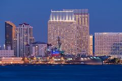 USS Midway and San Diego. USS Midway Aircraft Carrier Museum and San Diego Skyline at Night. California USA stock image