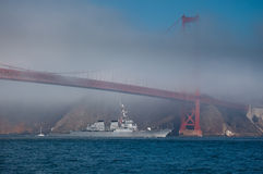 USS Milius glides under Golden Gate Bridge Stock Photo