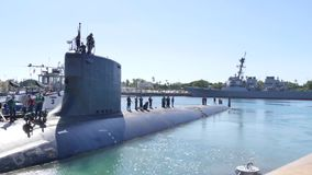 USS Mississippi drives out Pearl Harbour. The submarine Verginia Class USS Mississippi drives out of Pearl Harbour. A tug drives beside it stock video