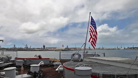 USS Missouri backside flag. HONOLULU, OAHU, HAWAII, USA - AUGUST 21, 2016:backside flag of USS Missouri BB-63 warship at Pearl Harbor base. entered Tokyo Bay on stock video footage
