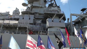 USS Missouri flags. HONOLULU, OAHU, HAWAII, USA - AUGUST 21, 2016:flags of USS Missouri BB-63 warship at Pearl Harbor base. entered Tokyo Bay on 29 August for stock video