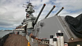 USS Missouri tourist. HONOLULU, OAHU, HAWAII, USA - AUGUST 21, 2016: prow with canons of USS Missouri BB-63 warship at Pearl Harbor base. Commissioned in June stock video footage