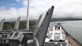 USS Missouri tourists. HONOLULU, OAHU, HAWAII, USA - AUGUST 21, 2016: prow with cannons of USS Missouri BB-63 warship at Pearl Harbor base. Commissioned in June stock video footage
