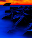 在USS亚特兰提斯海难的日落的长的曝光在日落海滩,开普梅的。NJ 图库摄影