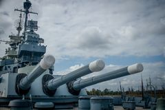 USS North Carolina Aft Guns. The large aft artillery on the USS North Carolina battleship, moored along the Cape Fear River, in Wilmington, NC, USA Royalty Free Stock Photography