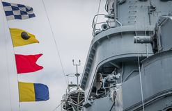 USS North Carolina Nautical Flags. An array of nautical flags flying on the USS North Carolina battleship, moored along the Cape Fear River, in Wilmington, NC stock photos