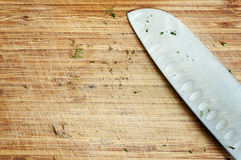 Ussed knife on rustic kitchen table Royalty Free Stock Images