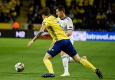 Ussia national team striker Dmitry Poloz and Sweden national team player Victor Lindelof. Solna, Sweden - November 20, 2018. Russia national team striker Dmitry royalty free stock images