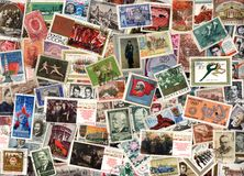 Horizontal background of soviet postage stamps. USSR - circa 1950-1990: Horizontal background of soviet postage stamps including stamps with portraits, sports Royalty Free Stock Photography