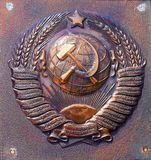 USSR coat of arms close up shot. Historical item Stock Images