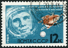 USSR - 1964: shows Portrait of Yuri Gagarin 1934-1968 and stellite, series Leaders in rocket theory and technique Stock Photos