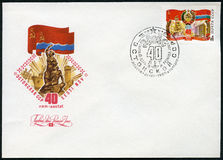 USSR - 1980: shows Russian flag and arms, Estonian flag, monument, building, devoted Estonian SSR, 40th anniversary Stock Image