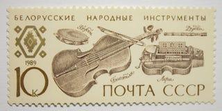 USSR stamp with Belarussian basset, lera, pipe, tambourine. stock image