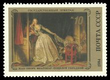 Painting The stolen Kiss. USSR - stamp 1984: Color edition on French Art, Shows Painting The stolen Kiss by Jean-Honore Fragonard Royalty Free Stock Photo