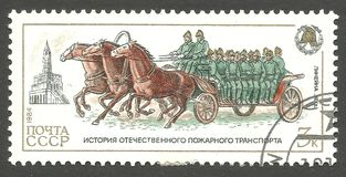 Horse drawn crew wagon. USSR - stamp 1984, Issue Emergency rescue services, Fire brigades, Series History of Fire Engines, Horse drawn crew wagon Royalty Free Stock Photo
