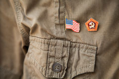 USSR & USA flag, historic national emblem on a khaki shirt person chest Royalty Free Stock Image
