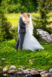 Ust married couple at meadow kissing Royalty Free Stock Photo