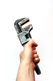 Ustable Wrench. A hand grasping Adjustable Wrench Royalty Free Stock Images