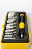 Ustawia śrubokręt w czerni i koloru żółtego pudełku Obraz Royalty Free