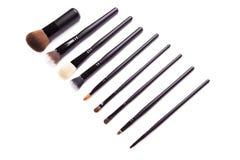 Ustawia inkasowego fachowego kosmetyka muśnięcie dla makeup, na odosobnionym białym tle Obraz Royalty Free