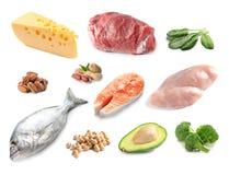 Ustawia z różnym naturalnym proteinowym jedzeniem na białym tle fotografia royalty free