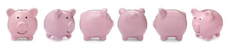 Ustawia z różowym prosiątko bankiem od różnych widoków fotografia royalty free