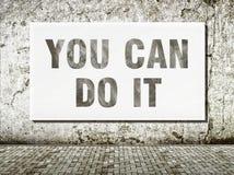 Usted puede hacerlo, palabras en la pared Imágenes de archivo libres de regalías